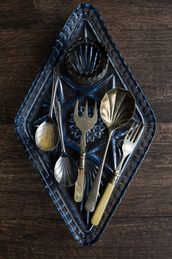 Vintage spoons and forks on glass tray