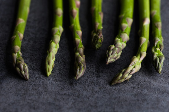 Asparagus tips on table