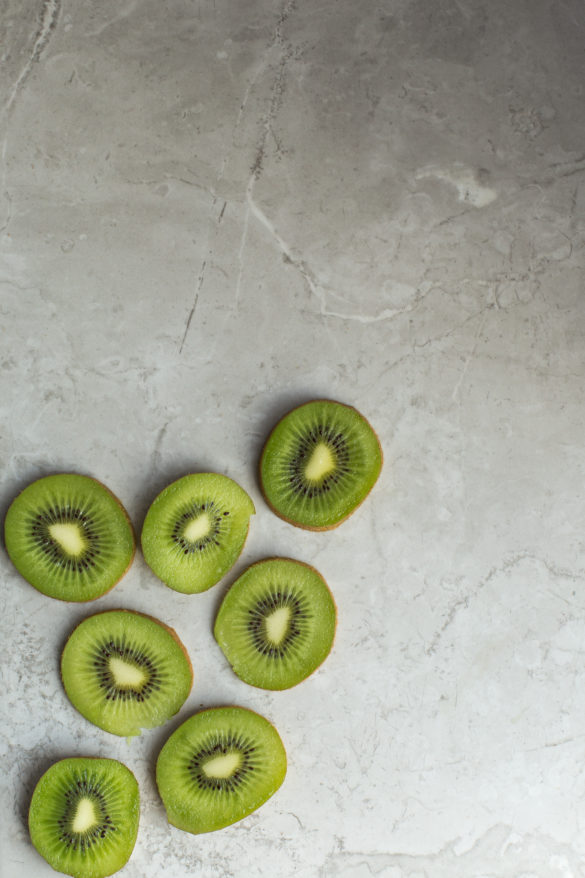 sliced kiwi on table