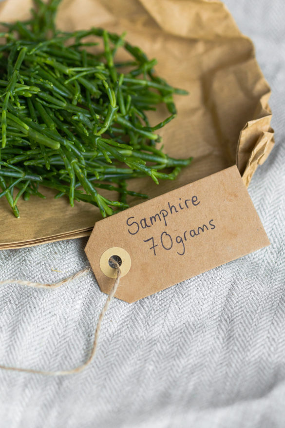 samphire in brown paper on table