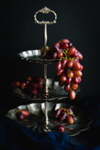 Red Grapes on Silver Stand
