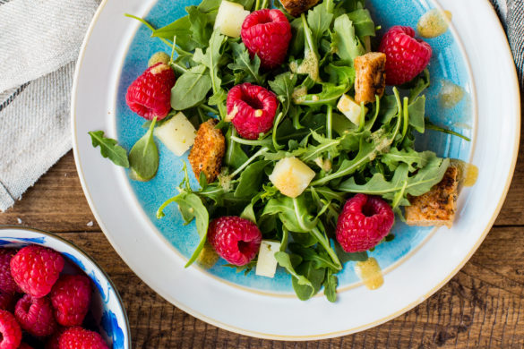 raspberry and rocket salad on table