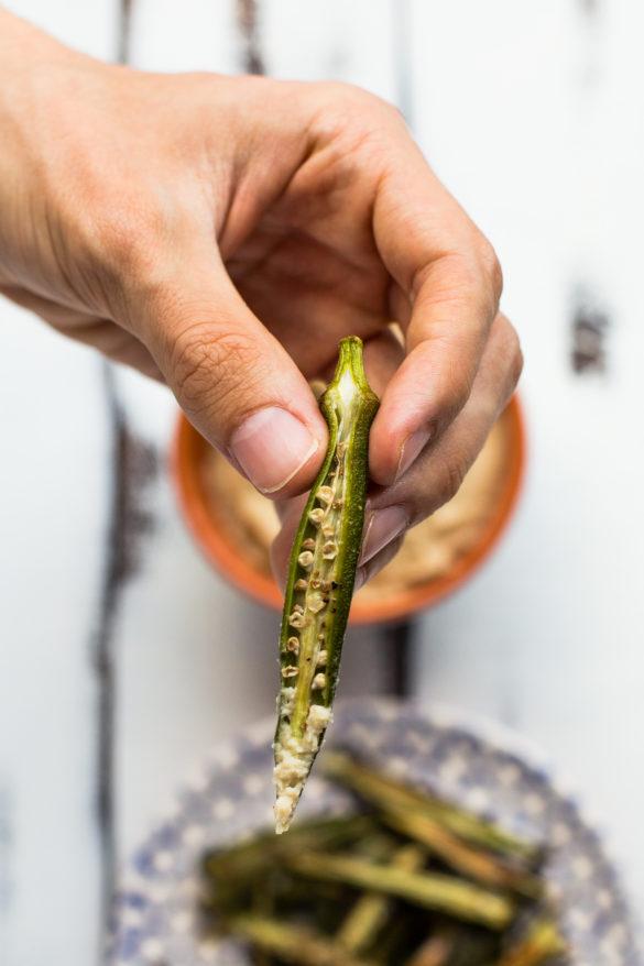 Dipping okra fries in butterbean dip