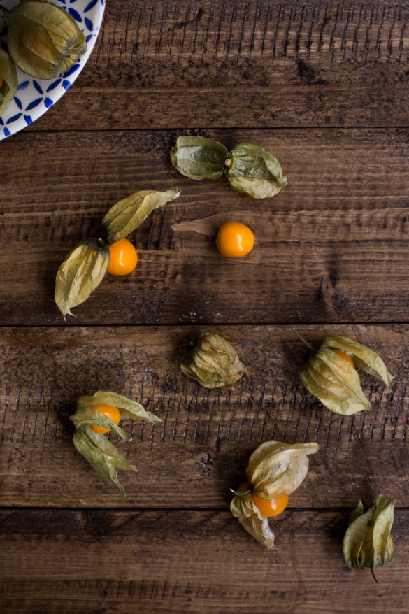 Physalis fruit scattered on rustic table