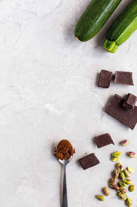 Ingredients for chocolate courgette cake on table