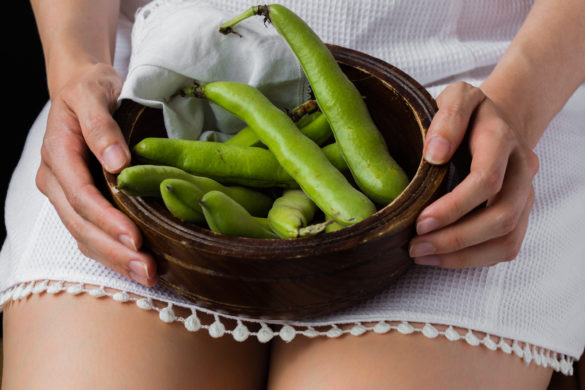Girl sitting with bowl of broad beans
