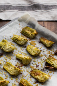 artichoke hearts on baking sheet