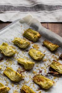 artichoke hearts on baking sheet
