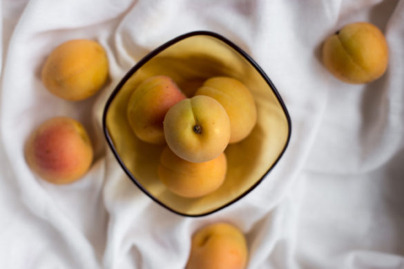 Apricots in yellow bowl
