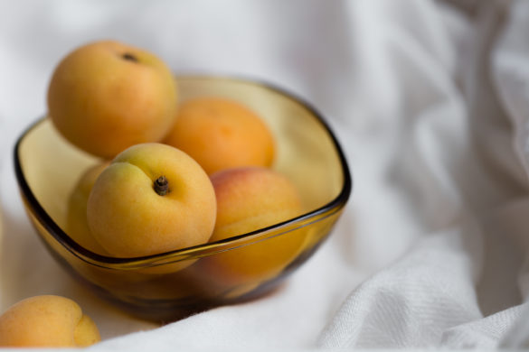 Apricot fruits in yellow glass bowl