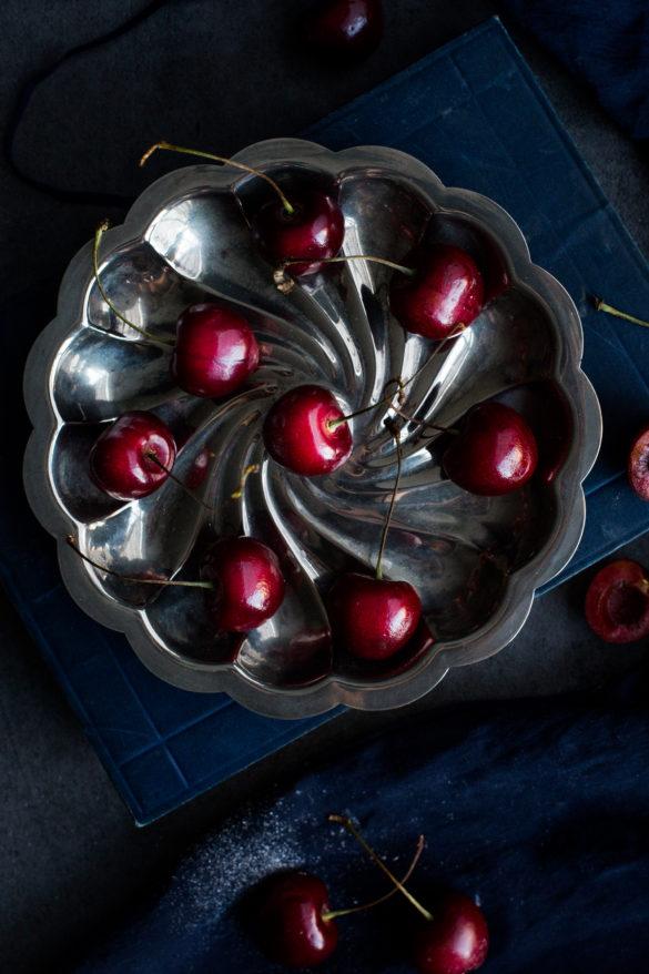 Portrait of cherries on silver platter