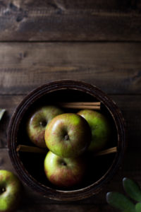Apples in bowl on rustic table