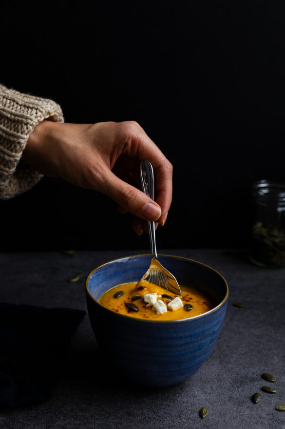 Butternut squash soup in bowl on slate