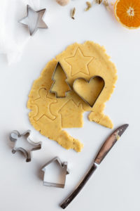 Raw Biscuit Dough with Festive Cookie Cutters on White Table