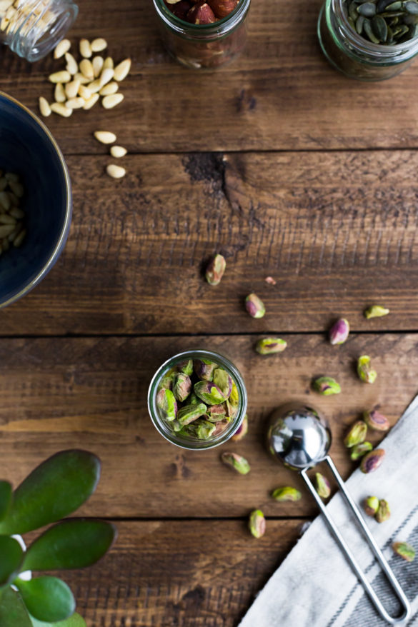 Pistachios and other nuts on rustic wooden table
