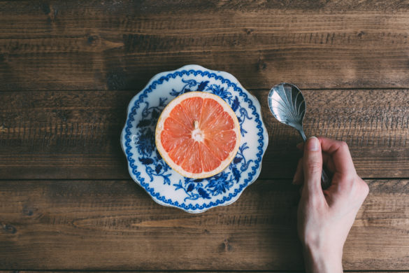pink grapefruit on wooden table