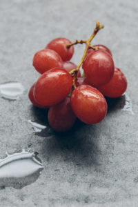 Red Grapes on Slate Table