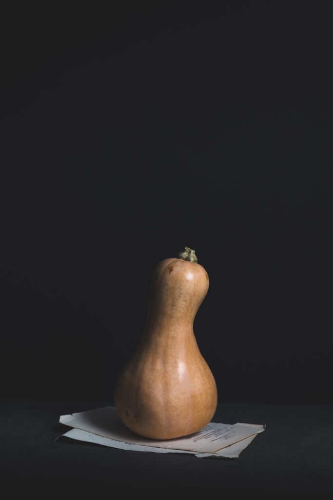 butternut squash against black background