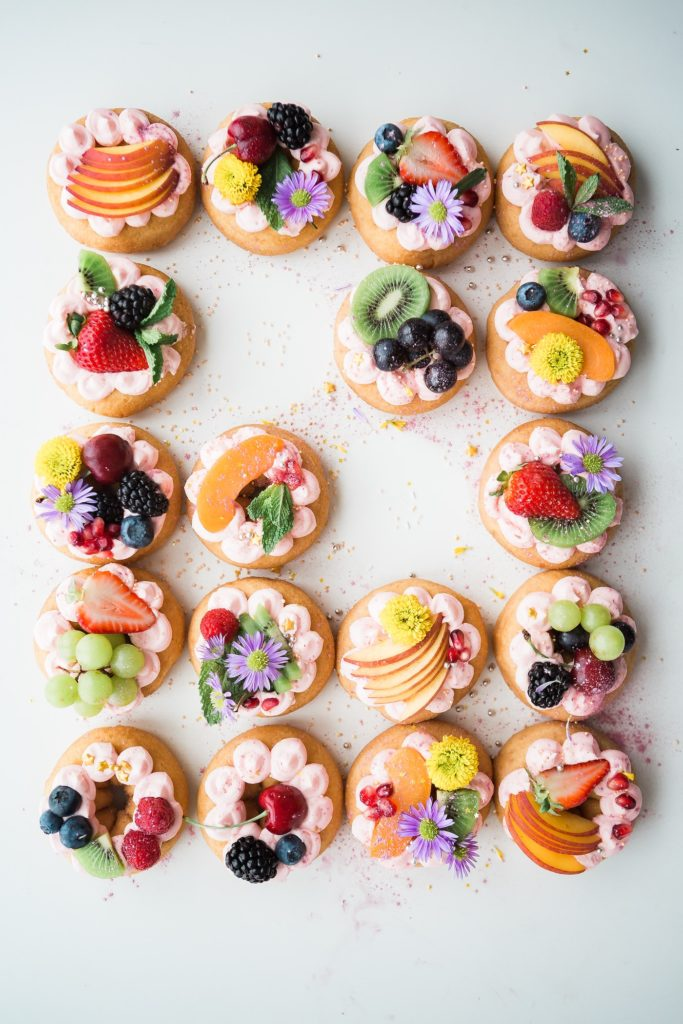 colourful fruits on cakes